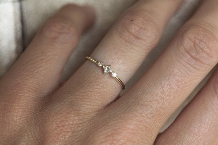 Petite Diamond Engagement Ring, Princess Diamond Engagement, Simple Gold Diamond Ring, Three Stone Ring, Three Diamond Ring by capucinne on Etsy https://www.etsy.com/listing/242816002/petite-diamond-engagement-ring-princess