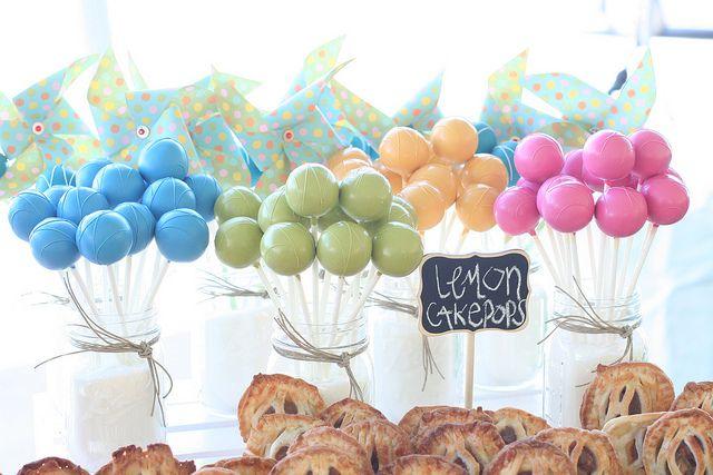 Cake pops displayed in mason jars with sugar