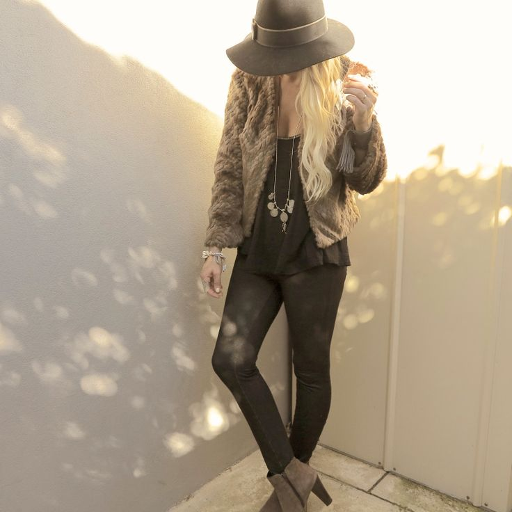 Basic black paired with a fur coat, suede ankle boots and boho sterling. Love these edgy bohemian threads. Gypsy Lovin Light.