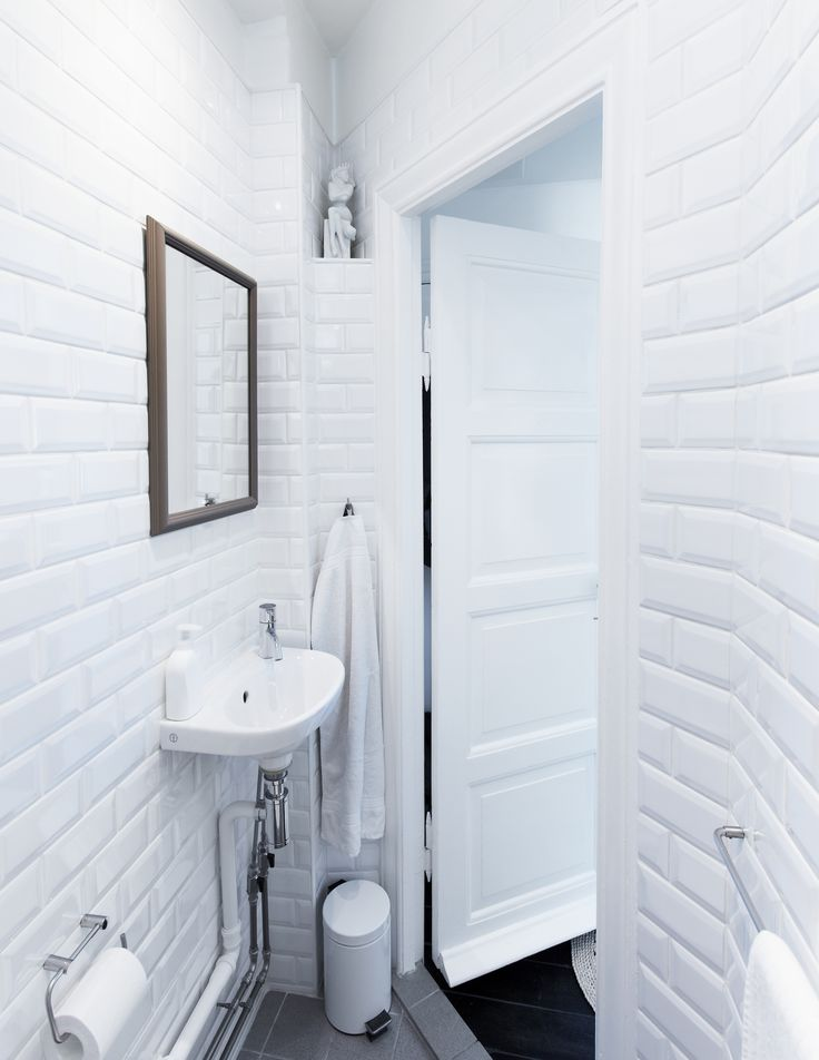 Small bathroom with Paris Metro-style tiles