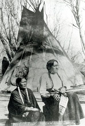 Sitting Bull and Travoriet, his Wife. Photograph by Bailey, Dix, and Mead. Fort Randall, South Dakota, 1882.