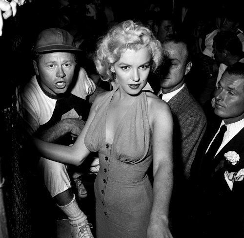 Marilyn Monroe and Mickey Rooney at the Hollywood Entertainers Baseball Game, 1952.