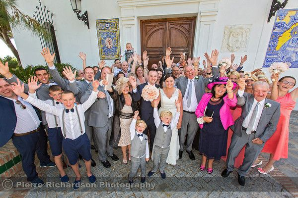Group shot outside of the Church after Catholic Wedding in Spain