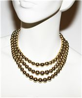 Monet - Triple Strand Gold Tone Beads at Tjinona.se