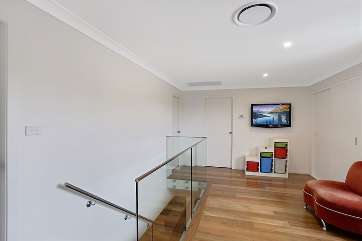upstairs living area with glass balustrade  #32DegreesBuilding #FirstFloorAddition #AdditionsSpecialist #SydneyBuilder #Stairs #TimberFloor