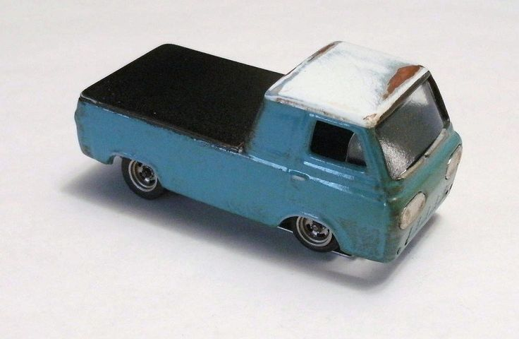 http://www.ebay.com/itm/custom-finished-resin-ford-econoline-pickup-ho-slot-car-w-chassis-/231729869640?