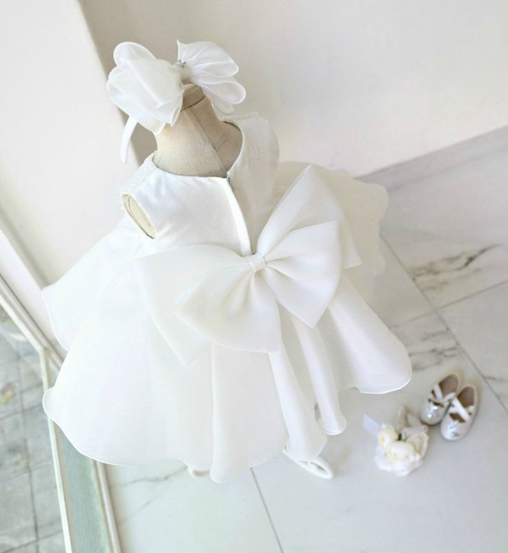 Stunning Big Bow Back Flower Girl Dress-Perfect for Birthday, Wedding, Christening, Baptism, Party Dress Or Baby Shower Gift. Available from Newborn - 15 Years. Material: Satin, soft polyester fiber, purified cotton lining, tulle mesh. #whitechildrendress #girldresses #whitebridesmaiddress #flowergirldress #highqualityflowergirldress #freeshippingchildrendress #bigbowgirldress #cutechildrendress #cutebirthdayoutfit