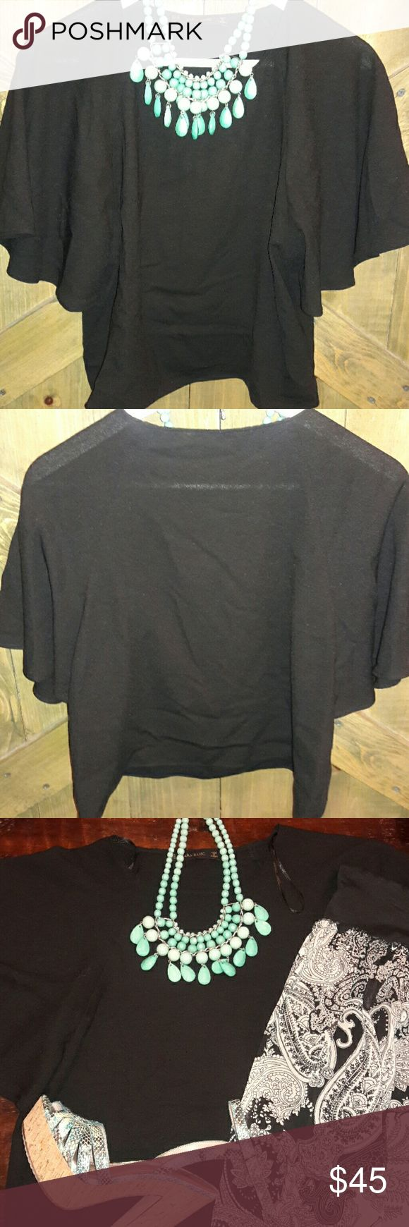 Zara Black batwing top This elegant look top with all its black richness, can be worn with just about anything... *100 Polyester *19' from armpit to armpit Zara Tops Tunics