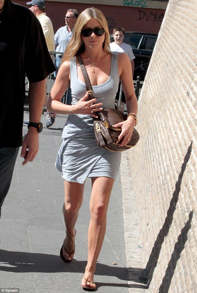 Next stop: Jennifer Aniston was spotted in Rome, Italy, earlier today, wearing a tight, little grey dress