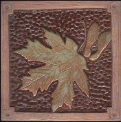 """6"""" Maple Leaf tile with green & chocolate glaze. Handmade relief tile by Fay Jones Day"""