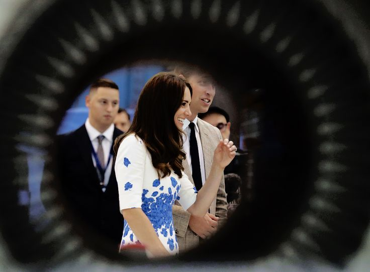Catherine, Duchess of Cambridge and Prince William, Duke of Cambridge, seen through a tube, speak to employees during a visit and opening of the Centre of Excellence for Hayward Tyler, the worldwide market leader in the manufacture of Boiler Circulating Pumps and specialist wet-wound motors on August 24, 2016 in Luton, England.