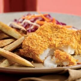 Oven-Fried Fish and Chips   Enjoy a healthier St. Patrick's day by cutting calories in half and reducing fat in our oven-fried fish and chips recipe. We coat the delicate fish in a crispy cornflake crust and then bake it along with sliced potatoes. Serve with: Coleslaw and malt vinegar or lemon wedges.