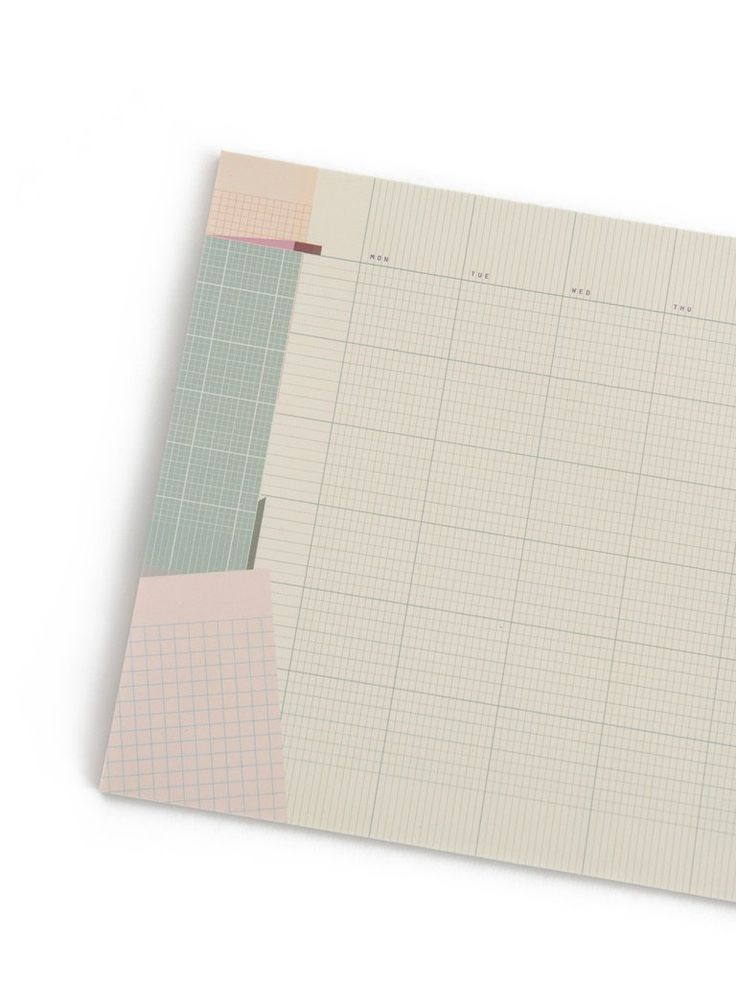 Monthly collage desk pad with graph squares for bullet journalling.