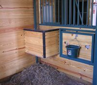 Horse barn stall photo with hay and water accommodations
