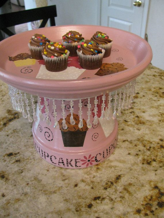 Stylish Dessert Tray is painted with Cupcake decor!  Cupcakes painted on top and all the way around.  Beads hang down and are located underneath the top