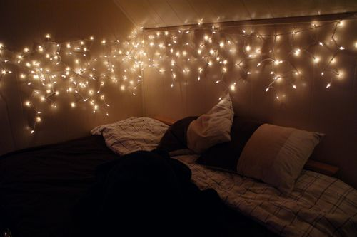 Love this. These almost look like icicle lights. From the blog: 'Using Fairy Lights Around the Home'.