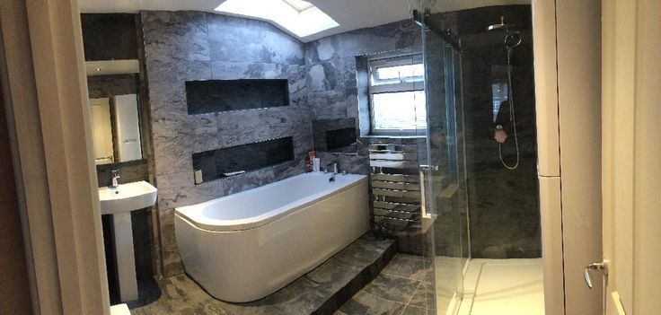 Gareth from Bristol uses a striking dark wall and floor tiles to make his white curved bath standout. #VPShareYourStyle