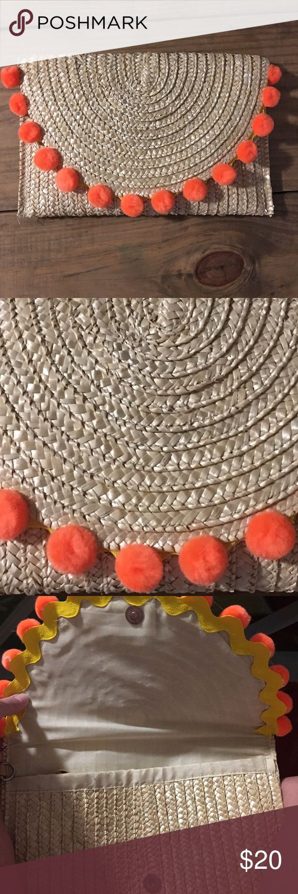 """PomPom Straw Clutch""""TOP TRENDS HOST PICK"""" Adorable Straw clutch with bright orange pompoms. Never used!! 12""""w x 8""""h. Removable Wrist strap will be included but seams of the strap shows glue. Bags Clutches & Wristlets"""