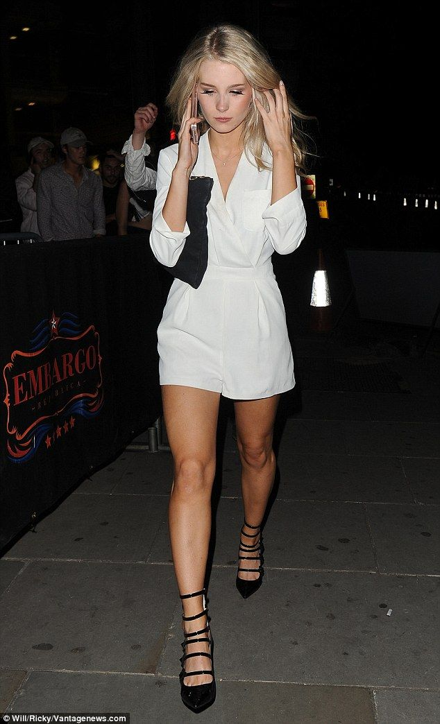 Model moment: Lottie Moss partied up a storm with pals at London's exclusive Embargo nightclub on July 30