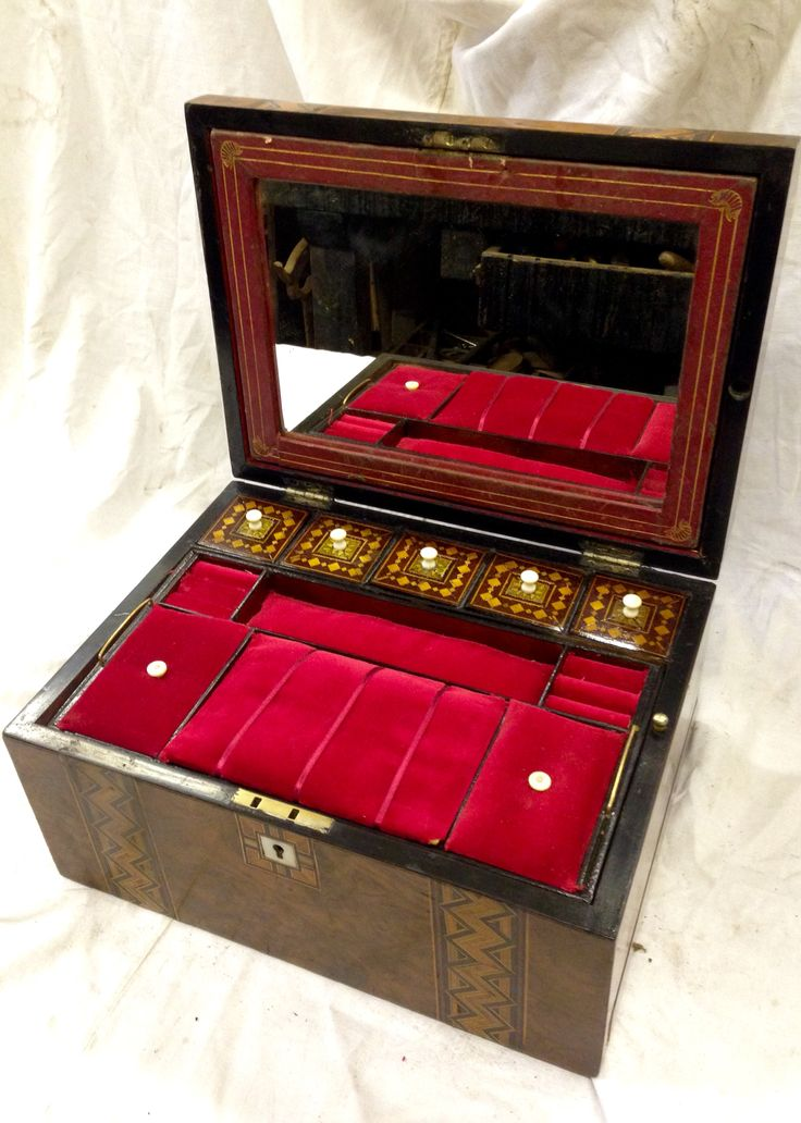 Antique ladies walnut jewellery box fitted interior and lift out tray . With 5 lids on bone handles