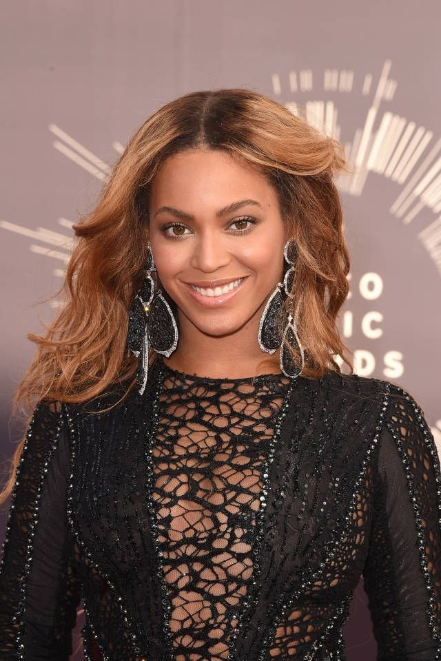 Beyonce teams up with Topshop for athletic apparel line.