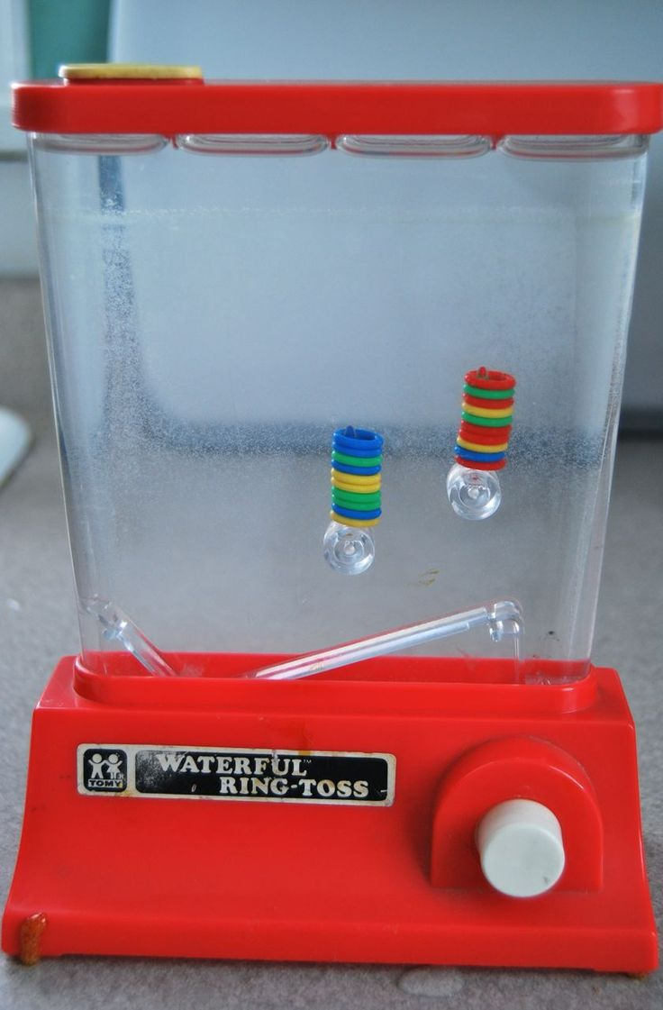 So kids now have iphones and ipads and pocket video games...this is what i had for long car rides...a water ring toss...yeah...no wonder i got car sick so often.