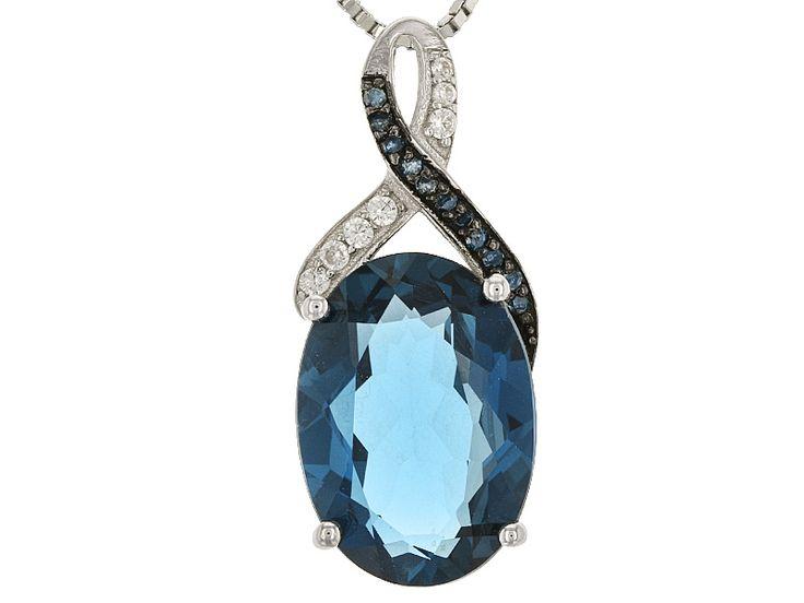 6.16ct Oval London Blue Topaz, .04ctw Round Blue Diamond, And .07ctw Round White Zircon Silver Ring