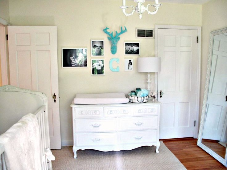 We love an all-white nursery! The turquoise accents add a beautiful pop of color.All Whit Nurseries, White Nurseries, Baby Cranes, Baby Lynn, White Nursery, Projects Nurseries, White Baby, Gallery Wall, Baby Nurseries