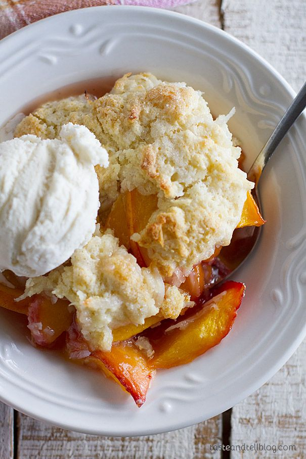This Coconut Peach Cobbler recipe takes the sweet peaches of the season and turns them into a delicious cobbler with a twist.