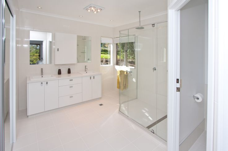 Spacious designs can open up a mid-sized bathroom. www.onecallkitchens.com.au