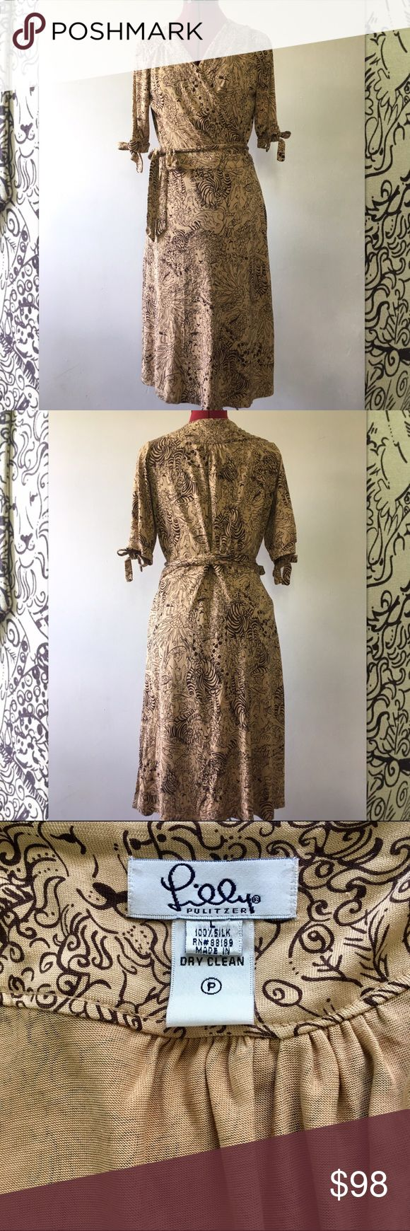Vintage Lilly Pulitzer Animal Print Wrap Dress Vintage Lilly Pulitzer 100% silk animal print wrap dress in tan and brown. Gently worn like new condition. This is one of my favorite dresses, but I haven't worn it in a few years. Price is firm. Lilly Pulitzer Dresses Midi