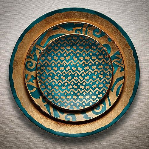 Fortuny patterned dinnerware in teal and gold