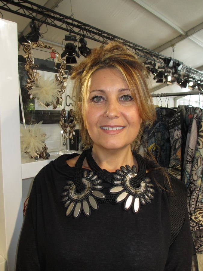Linda of Emaux Deco, Cannes came by our booth at the Premiere Classe Tuilerries show and could not resist our Fleur du Mal striking necklace... #DoriCsengeri #statement #necklace #leather #fallfashion