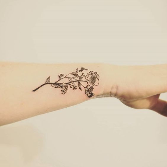 Beautiful, colorful, black, simple flower tattoos and floral tattoo designs, ideas. Flower arm, sleeve, wrist tattoos More at http://factoflife.net/plants/beautiful-colorful-small-simple-flower-tattoos-tatoo-designs.html
