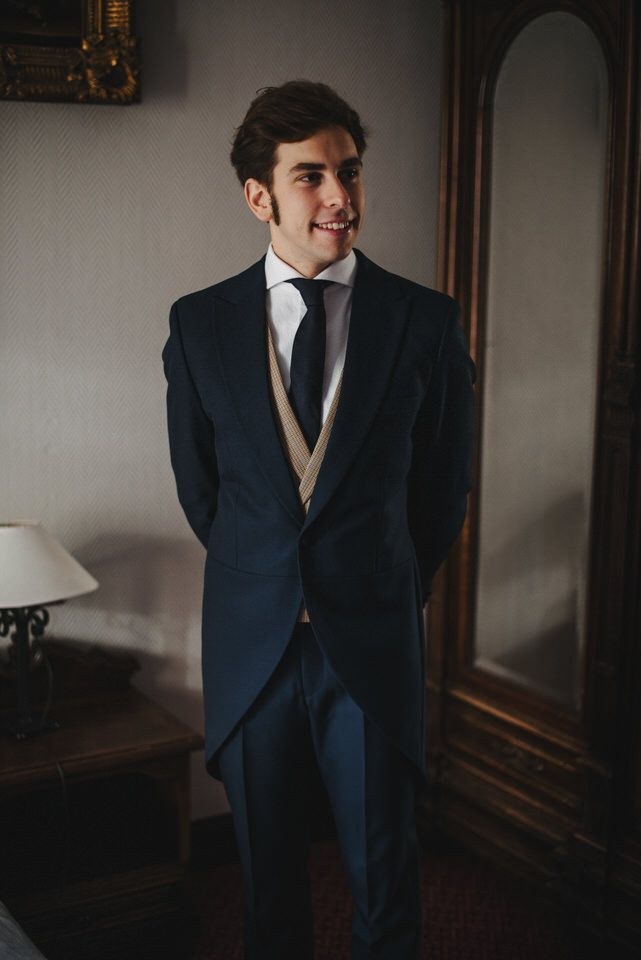 Groom wore a deep navy suit over a burlap inspired pattern vest with a matching necktie.