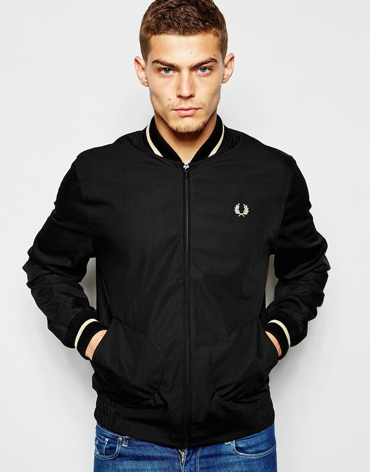"Bomber Jacket by Fred Perry Laurel Wreath Collection Woven fabric Ribbed trims with tipping Zip placket Embroidered logo Side pockets Fitted hem and cuffs Regular fit - true to size Machine wash 65% Polyester, 35% Cotton Our model wears a size Medium and is 189cm/6'2.5"" tall"