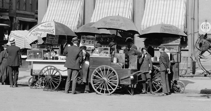 A typical New Yorker hot dog stand, they are selling frankfurters for three cents, or you can buy two hot dogs for five cents. Hot dogs are becoming more and more popular these days.