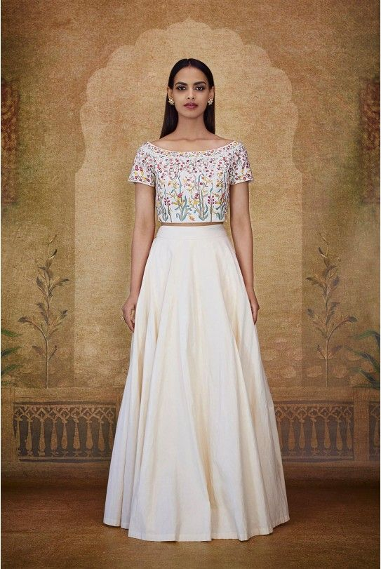 A natural-hued Malkha crop top with colourful printed floral and vine motifs inspired by a magical forest. Paired with a natural-hued Malkha flared skirt.