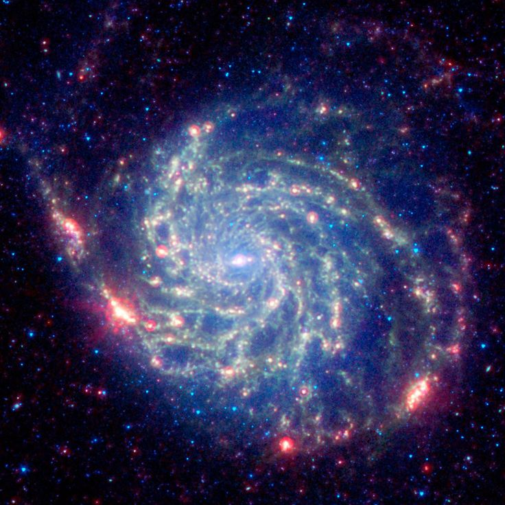 The Pinwheel Galaxy in visible light vs. infrared.   9 Pictures That Will Make You See The Universe Differently