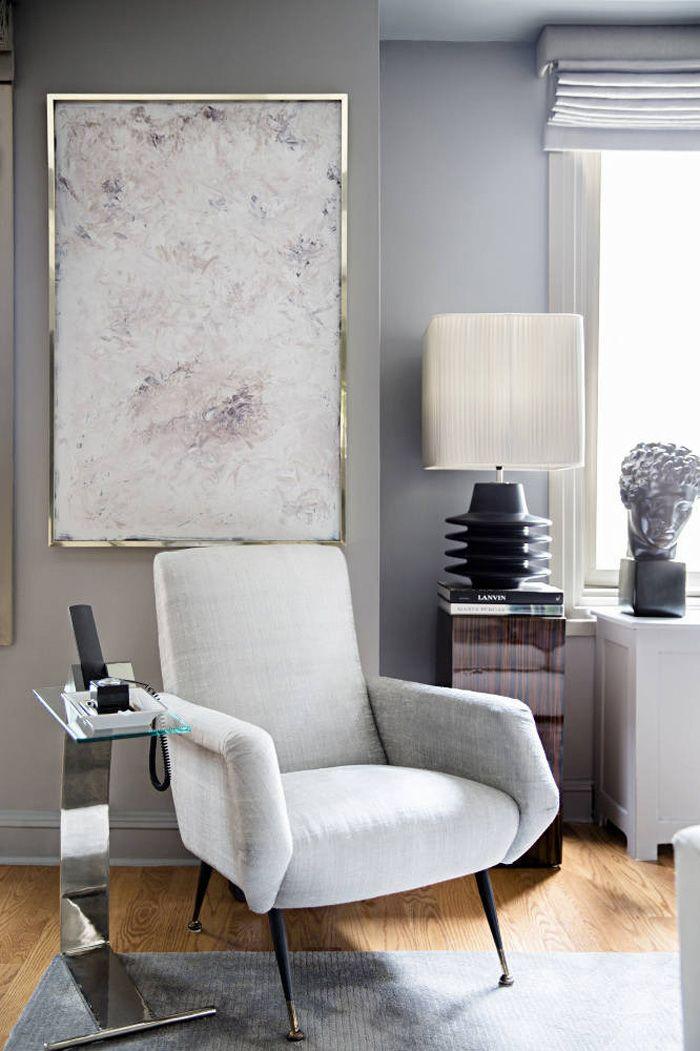 Ryan Korban NYC apt living room gray walls silver abstract painting brass chrome