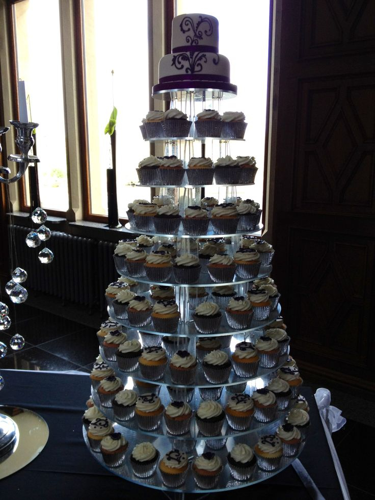 Purple wedding cupcakes Make a dessert stand out of log pieces stacked