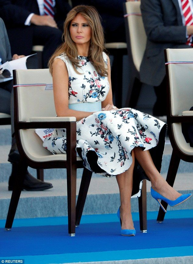 Melania looked impeccably polished this morning in an elegant floral dress in Paris. First Lady Melania Trump, Paris, floral print white dress, blue shoes. July 14 2017, elegant, cool, classy, refined