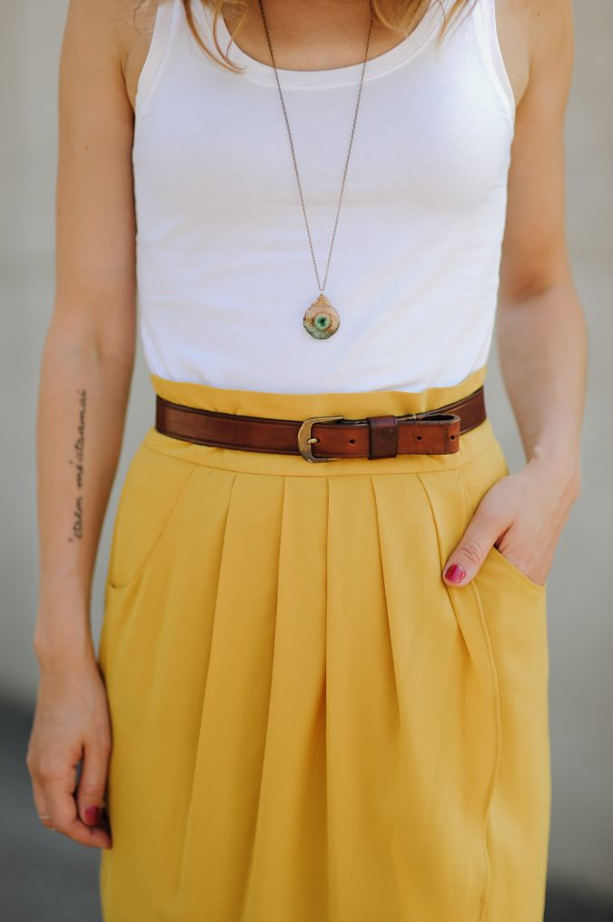 White tank with a brightly colored skirt.