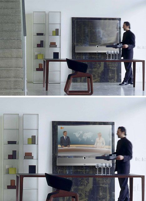 The transparent tv designed by Michael Friebe. Or, we just buy a nice projector and a high thread count white bedsheet and duct tape it to the huge white wall above the stairs.