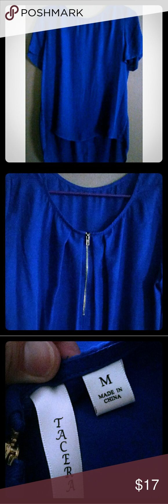 Royal blue high-low top Royal blue high-low top; only worn once. Women's size medium. Has a beautiful zippered neck (back photo) and the material is very flowy. Would go perfect with leggings, jeans, or even a skirt. Also, could be easily dressed up or dressed down with the perfect accessories. Tacera Tops Blouses
