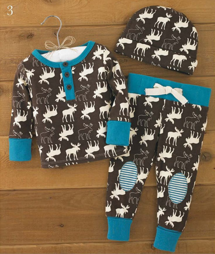 A darling first outfit for baby boy, this newborn 3-piece cotton pajama set features an all-over moose pattern to bring baby into the natural world. The set includes cap, long sleep top and elastic waist pants with faux drawstring and contrasting knee patches. Arrives with padded hanger. Part of Mud Pie's Forest Friends collection.