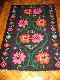 Beautiful antique traditional Romanian woven wool carpet / rug with floral pattern . Absolutely stunning and vivid colors . Hand woven in Transylvania 50-60 years ago .  Available at www.greatblouses.com
