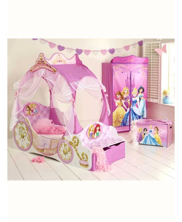 Transport your little princess into a fairytale fantasy with her very own Disney Princess Carriage Toddler Bed. Draped with pretty voile and featuring her favourite Disney Princesses, the Disney Princess Carriage Bed is every little girl's dream come true. The perfect height for little legs to hop up on, the delightful Disney Princess Carriage Toddler Bed is practical too, with protective side panels to stop bedtime tumbles, a sturdy MDF bed frame to keep her safe and snug and an inbuilt…