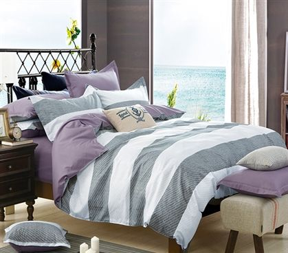 Shop at DormCo for our Orchid Frost Twin XL Comforter. This dorm necessities item features gray and white-gray stripes on the front while the reverse side is a solid orchid color for versatility in dorm room decor while adding comfort to your bedding