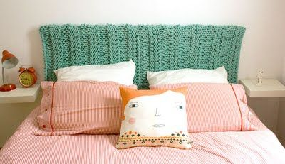A blanket covering a headboard. Great idea and easily changed.